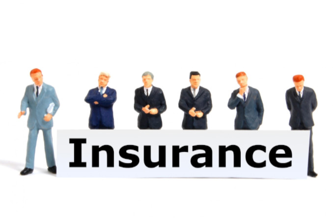 Insurance concept with toy businessmen: Max Filings After Incorporation Blog