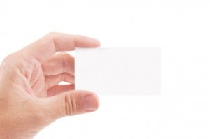 Hand holding blank business card: MaxFilings Corporations & LLCs Blog