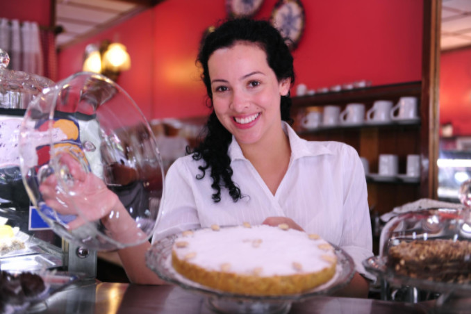 Woman in bakery: MaxFilings Small Business News Blog