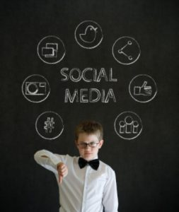 Social media kid with thumbs down: MaxFilings Small Business Marketing Blog