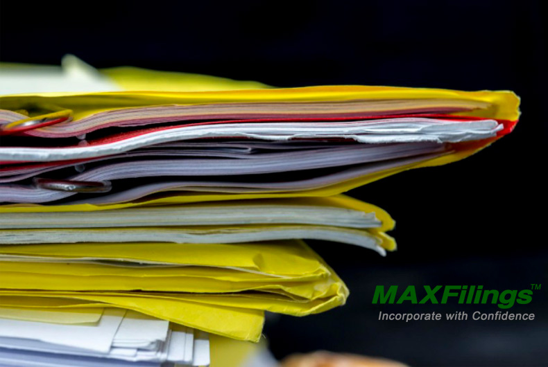 stack of paperwork and business documents