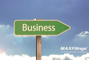 "green sign that reads ""business"" on a blue sky background"
