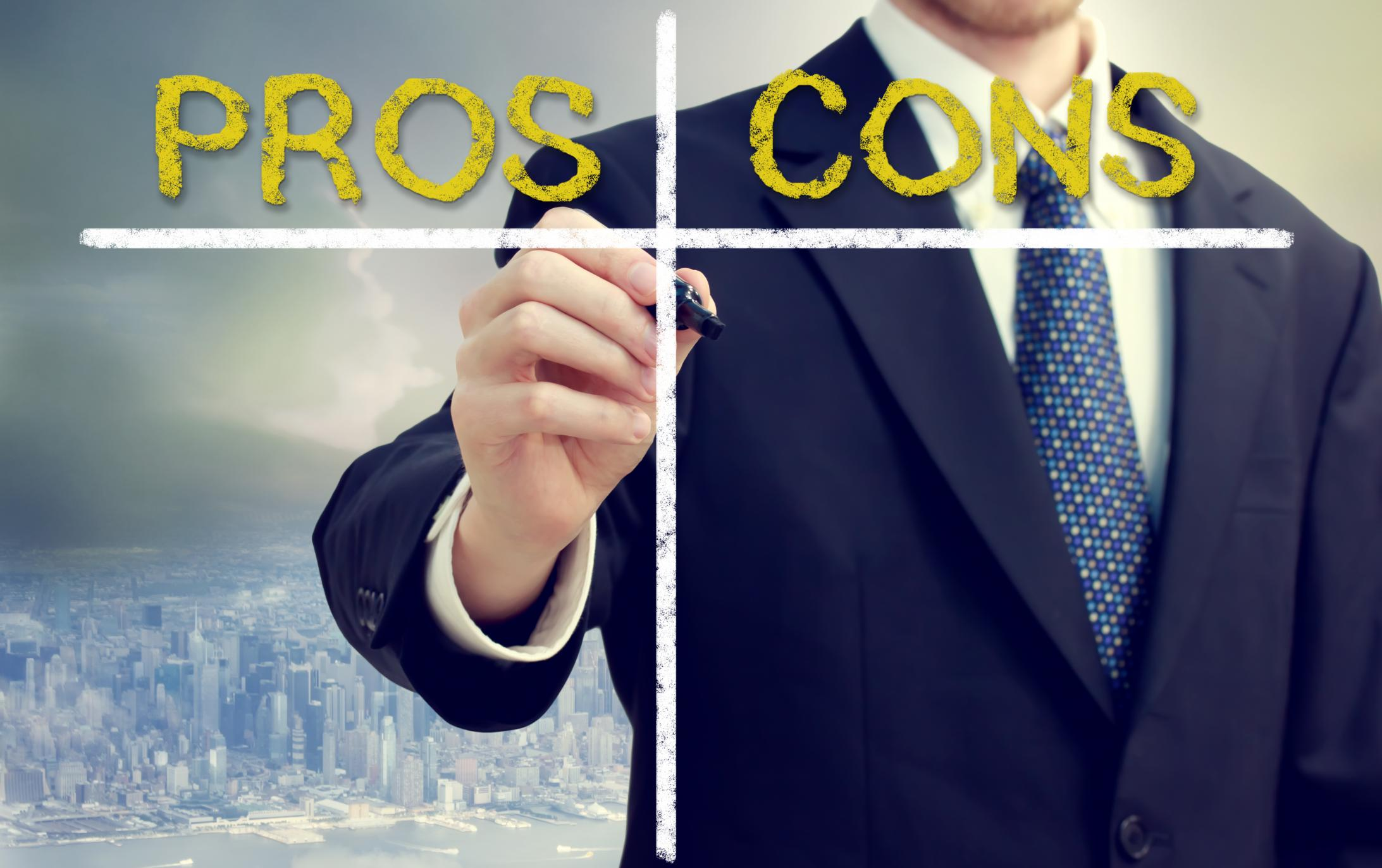 business-man-writing-pros-and-cons